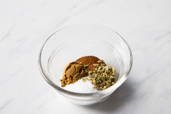 bowl with spices for shredded pork recipe.